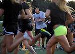 (Medfield Ma 07814) Ron Gronkowski, with watch, clocks the 40 yard sprint final, during the woman's football clinic at Medfield High School Friday evening. (Jim Michaud Photo) For Saturday