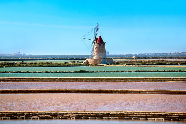Salt pans near Ettore Infesera windmill, Masala Sicily. travel stock photos