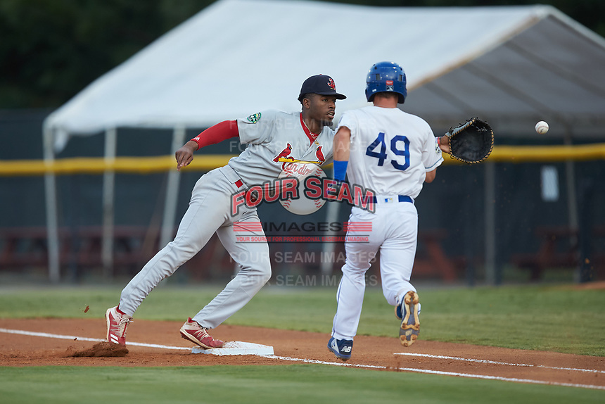 Johnson City Cardinals first baseman Todd Lott (29) reaches for a wide throw as Jack Gethings (49) of the Burlington Royals hustles down the line at Burlington Athletic Stadium on September 4, 2019 in Burlington, North Carolina. The Cardinals defeated the Royals 8-6 to win the 2019 Appalachian League Championship. (Brian Westerholt/Four Seam Images)