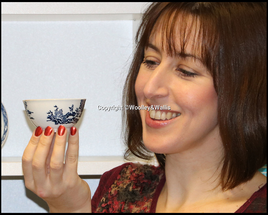 BNPS.co.uk (01202 558833)<br /> Pic:  Woolley&Wallis/BNPS<br /> <br /> Clare Durham from Woolley and Walllis with the the bowl.<br /> <br /> A tea bowl and saucer which were bought on eBay for £1,000 could sell at auction for 100 times that amount.<br /> <br /> The savvy collector took a punt on the items as he believed they could have been made by trailblazing English potter John Bartlam.<br /> <br /> Bartlam, who was originally was Staffordshire, was responsible for the first pieces of porcelain fashioned in America 250 years ago.<br /> <br /> Scientific tests have proved the tea bowl and saucer were made at Bartlam's factory in Cain Hoy, South Carolina between 1765 and 1769.