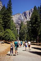 People walking towards Yosemite Falls in Yosemite National Park, California, USA