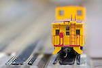 Hicksville, New York, USA. February 22, 2015. A Union Pacific yellow caboose model train car travels on the track at the Model Train Exhibit ihsted by Trainville Hobby Depot at the Broadway Mall, including an N Scale layout, the Long Island HOTrack train club HO scale model train portable modular layout, and Long Island Traction Society O Gauge Trolleys. Donations were accepted at exhibit to support the Nassau County Empire State Games for the Physically Challenged.