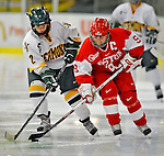 9 February 2008: Boston University Terriers' forward Gina Kearns, a Junior from Norwood, PA, battles University of Vermont Catamounts' forward Molly Morrison, a Freshman from So. Burlington, VT, at Gutterson Fieldhouse in Burlington, Vermont. The Terriers shut out the Catamounts 2-0 in the Hockey East matchup...Mandatory Photo Credit: Ed Wolfstein Photo