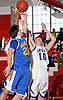Tanner Owens #10 of Long Beach, right, and Kyle DeVerna #22 of Kellenberg battle for a rebound during a non-league varsity boys' basketball game at Freeport High School on Monday, Jan. 18, 2016. Kellenberg won by a score of 71-62.