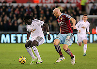 Pictured L-R: Bafetimbi Gomis against James Collins of West Ham Saturday 10 January 2015<br />