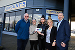 Eoin O'Flynn (R) Marketing manager Flogas Ireland presenting a cheque to (l to R) Michael Grogan Anne Dowd Natasha Roche and Lisa Kearney of Vincents outside their new shop premises in Bettystown.<br /> Picture Fran Caffrey | Newsfile