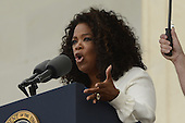 US actress and entertainer Oprah Winfrey delivers remarks during the 'Let Freedom Ring' commemoration event, at the Lincoln Memorial in Washington DC, USA, 28 August 2013. The event was held to commemorate the 50th anniversary of the 28 August 1963 March on Washington led by the late Dr. Martin Luther King Jr., where he famously gave his 'I Have a Dream' speech.<br /> Credit: Michael Reynolds / Pool via CNP