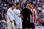 Sergio Ramos (L) and Carlos Henrique Casemiro (C) of Real Madrid and Stefan Savic (R) of Atletico de Madrid have words with the referee during La Liga match between Real Madrid and Atletico de Madrid at Santiago Bernabeu Stadium in Madrid, Spain. February 01, 2020. (ALTERPHOTOS/A. Perez Meca)