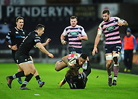 Cardiff Blues&rsquo; Willis Halaholo is tackled by Ospreys' Jeff Hassler<br /> <br /> Photographer Kevin Barnes/CameraSport<br /> <br /> Guinness Pro14 Round 13 - Ospreys v Cardiff Blues - Saturday 6th January 2018 - Liberty Stadium - Swansea<br /> <br /> World Copyright &copy; 2018 CameraSport. All rights reserved. 43 Linden Ave. Countesthorpe. Leicester. England. LE8 5PG - Tel: +44 (0) 116 277 4147 - admin@camerasport.com - www.camerasport.com