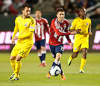 CARSON, CA – APRIL 9, 2011: Chivas USA midfielder Jorge Flores (19) moves past Columbus Crew midfielder Dejan Rusmir (22) during the match between Chivas USA and Columbus Crew at the Home Depot Center, April 9, 2011 in Carson, California. Final score Chivas USA 0, Columbus Crew 0.