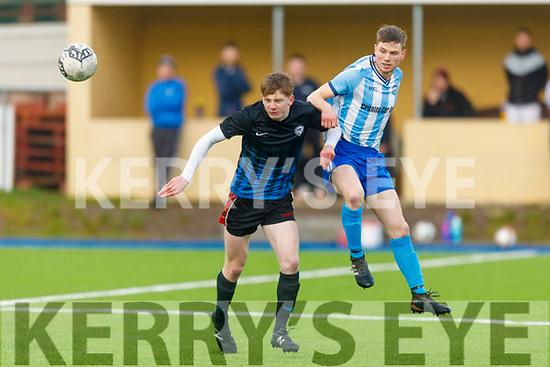 Castlemaine Utd's Ciaran Coffey and Cian O'Grady of  Clochan Breannainin  tussle for control of the ball in their encounter in Mounthawk Park on Sunday.