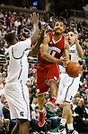 February 16, 2012; East Lansing, MI, USA; Wisconsin Badgers guard Jordan Taylor (11) goes to the basket while defended by Michigan State Spartans center Derrick Nix (25) and guard Brandon Wood (30) during a Big Ten Conference game at the Breslin Center. (Photo by Bob Campbell)