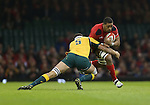 Australia lock Rob Simmons tackles Wales number 8 Taulupe Faletau.<br /> Dove Men Series 2014<br /> Wales v Australia<br /> Millennium Stadium<br /> 08.11.14<br /> &copy;Steve Pope-SPORTINGWALES
