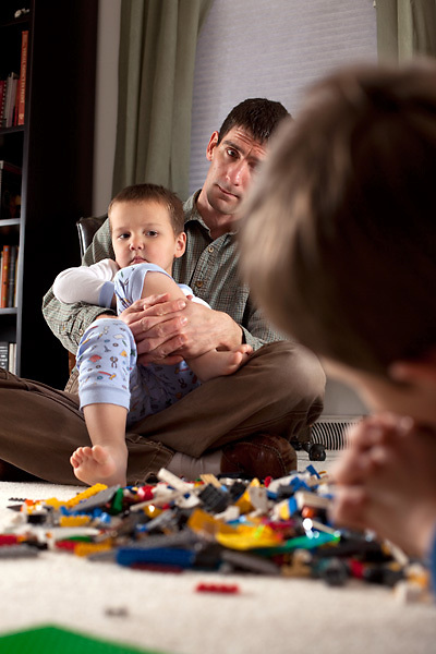 After having a Lego party with our sons, my husband tries to get them to calm down for a bedtime prayer.