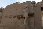 Statue of Ramses III standing at the gateway into the Great Temple of Amun.The Temple was built by Ramses III who ruled Egypt from 1186-1155BC . Karnak is part of the ancient city of Thebes ( built in and around modern day Luxor).The building of the Temple complex at Karnak began in the reign of the Pharaoh Senusret I who ruled Egypt from 1971-1926 BC. Approximately 30 Pharaohs contributed to the building of the complex and in so doing made it the largest ancient religious site in the world. The ancient name for Karnak was Ipet-isut (Most select of places).