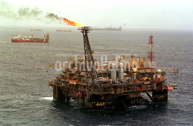Natural gas burns off at the Petrobras Palataforma 26, about 100 miles from the Brazilian coastline in the Campos Basin of the Atlantic Ocean. With the discovery of new oil deposits in the basin, Brazil hopes to start producing 2 million barrels a day, thus becoming self-sufficient.
