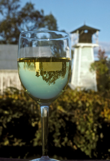 Chardonnay glass with traditional water tower in St. Helena, Ca