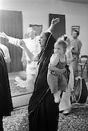 Hollywood, Los Angeles, CA - March 9, 1969<br /> Members of the religious organization, The International Society for Krishna Consciousness, inside of their new local  Krishna temple. They meditate, eat on the floor and play with their children.<br /> Hollywood, Los Angeles, Californie. 9 mars 1969.<br /> Les membres de la secte religieuse des Krishna, dans leur nouveau temple de Hollywood. Ils y &eacute;coutent de la musique, soignent leurs enfants ou mangent &agrave; m&ecirc;me le sol.