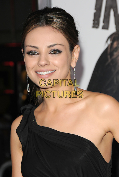 "MILA KUNIS .at Alcon Entertainment's L.A. Premiere of ""The Book of Eli"" held at The Chinese Theatre in Hollywood, California, USA,  January 11th 2010..portrait headshot make-up eyeliner black one shoulder dangly earrings hair up ponytail smiling .CAP/RKE/DVS.©DVS/RockinExposures/Capital Pictures."