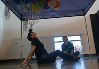 NWA Democrat-Gazette/CHARLIE KAIJO Paige Barajas, play facilitator, (left) balances balloons on her face as Dustin Griffith, lead exhibits developer, watches during the Zing in The New Year! event on Sunday, December 31, 2017 at Amazeum in Bentonville. Visitors wrote down New Year's wishes and made party hats and noise makers  and enjoyed the general activities