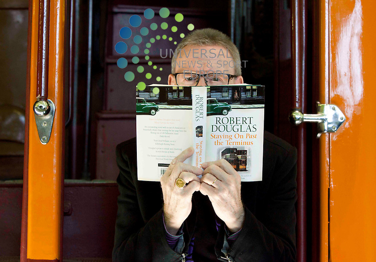 "Author Robert Douglas, (50) launches his latest novel ""Staying On Past The Terminus"" at the Glasgow riverside Museum, An engageing  story of life in Glasgow's tenements around 1961.. Picture: Johnny Mclauchlan Universal News and Sport (Europe)13/09/2011,"