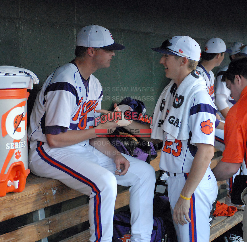 Starting pitcher Daniel Gossett (23) of the Clemson Tigers shakes hands with reliever Joseph Moorefield in a game against the Elon College Phoenix on March 21, 2012, at Fluor Field at the West End in Greenville, South Carolina. Clemson's 4-2 win was Gossett's first college win and head coach Jack Leggett's 1,200th career win.  .