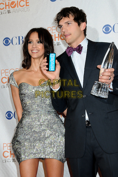 JESSICA ALBA & ASHTON KUTCHER .36th Annual People's Choice Awards - Press Room held at the Nokia Theatre LA Live, Los Angeles, California, USA, 6th January 2010..half length phone mobile grey gray dress silver print black tux tuxedo award winner trophy purple bow tie  .CAP/ADM/BP.©Byron Purvis/Admedia/Capital Pictures