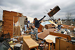 Logan Shipley helps to remove debris from a friend's home in Atkins, Ark. Wednesday, Feb 06, 2008. Tornadoes ripped through the small community Tuesday night leaving several people dead.