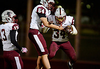 La Follette's Colin Spring (13) and Ben Rolloff (54) celebrate a first quarter touchdown by Jaylend Brown (34), as Madison La Follette takes on Verona in Wisconsin Big Eight Conference high school football on Friday, 10/4/19 at Verona High School's Curtis Jones Field