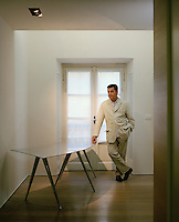 Architect Antonio Citterio photographed in the elegantly minimal entrance hall of his apartment