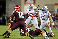 Virginia Tech Hokies quarterback Michael Brewer (12) is pursued by Ohio State Buckeyes defensive end Sam Hubbard (6) during Monday's NCAA Division I football game in Blacksburg, Va., on September 7, 2015. Ohio State won the game 42-24. (Dispatch Photo by Barbara J. Perenic)