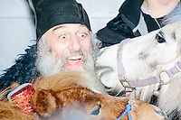 Satirical presidential candidate Vermin Supreme poses with people and ponies before delivering a stump speech at Ten Rod Farm in Rochester, New Hampshire. Supreme's platform advocates a pony-based economy, using zombies to solve the energy crisis, and other outlandish ideas. Supreme has been on the New Hampshire primary ballot in 2008 and 2012, though he began running for president in 1992. Vermin Supreme will be on the Democratic party ballot in the 2016 New Hampshire primary.