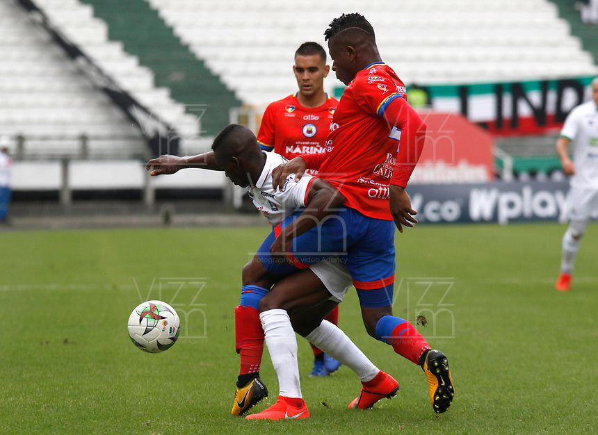 MANIZALES - COLOMBIA,17-03-2019: Johan Carbonero (Izq.) jugador del Once Caldas disputa el balón con Mairon Quinones (Der.) jugador del Deportivo Pasto durante partido por la fecha 10 Liga Águila I 2019 jugado en el estadio Palogrande de la ciudad de Manizales. /Johan Carbonero (L) player of Once Caldas fights for the ball with Mairon Quinones (R) player of Deportivo Pasto during the match for the date 10 of Aguila League 2019  played at the Palogrande Stadium in Manizales city. Photo: VizzorImage / Santiago Osorio / Contribuidor