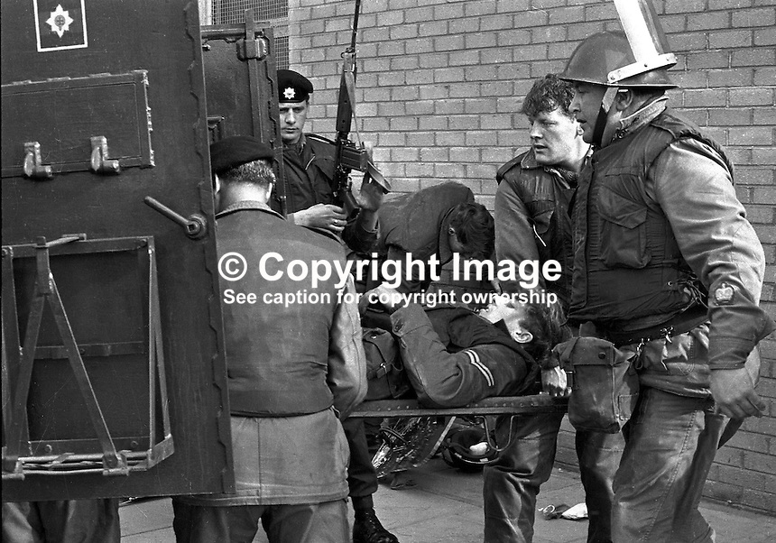 Soldier is stretchered into armoured personnel carrier after being injured in clashes with rioters in the Bogside district of Londonderry, N Ireland, UK. August 1969, 196908000645.<br />