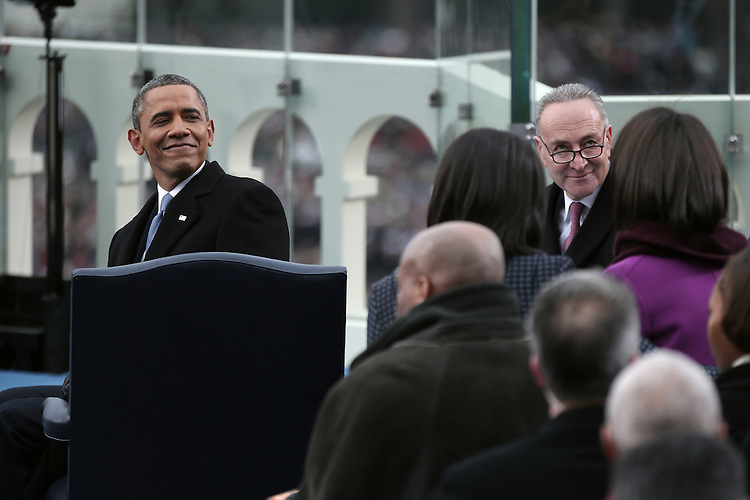 WASHINGTON, DC - JANUARY 21: U.S. President Barack Obama (L) and U.S. Sen. Charles Schumer (D-NY) look on during the public ceremonial inauguration on the West Front of the U.S. Capitol January 21, 2013 in Washington, DC.   Barack Obama was re-elected for a second term as President of the United States.  (Photo by POOL Win McNamee/Getty Images)