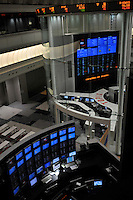 Traders at the Tokyo Stock Exchange.  Stocks in Tokyo have plummeted in recent months as Japan's economy has taken a pounding  as industrial production in Japan plunged at the steepest pace in 55 years in the fourth quarter, and unemployment rose at the fastest rate in 41 years with exports in the third quarter were a record 13.9 per cent lower than in the previous quarter.