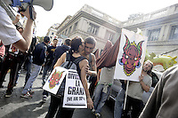 Roma 14 Ottobre 2011.Indignati in corteo dal Palazzo delle Esposizioni a Piazza Monecitorio
