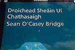 Sign for Sean O'Casey bridge crossing River Liffey, Dublin Docklands, Ireland, Irish Republic in English and Gaelic