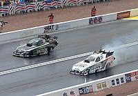 Apr. 7, 2013; Las Vegas, NV, USA: NHRA funny car driver Alexis DeJoria (left) defeats John Force during the Summitracing.com Nationals at the Strip at Las Vegas Motor Speedway. Mandatory Credit: Mark J. Rebilas-