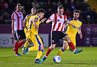 Lincoln City's Harry Anderson vies for possession with Chester's Theo Vassell<br /> <br /> Photographer Andrew Vaughan/CameraSport<br /> <br /> Vanarama National League - Lincoln City v Chester - Tuesday 11th April 2017 - Sincil Bank - Lincoln<br /> <br /> World Copyright &copy; 2017 CameraSport. All rights reserved. 43 Linden Ave. Countesthorpe. Leicester. England. LE8 5PG - Tel: +44 (0) 116 277 4147 - admin@camerasport.com - www.camerasport.com