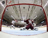 Matt Lombardi (BC - 24) watches Barry Almeida's shot hit the net behind Paul Dainton (UMass - 31). - The Boston College Eagles defeated the University of Massachusetts-Amherst Minutemen 5-2 on Saturday, March 13, 2010, at Conte Forum in Chestnut Hill, Massachusetts, to sweep their Hockey East Quarterfinals matchup.