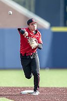 Rutgers Scarlet Knights second baseman Tim Dezzi (4) warms up before the NCAA baseball game against the Michigan Wolverines on April 26, 2019  at Ray Fisher Stadium in Ann Arbor, Michigan. Michigan defeated Rutgers 8-3. (Andrew Woolley/Four Seam Images)