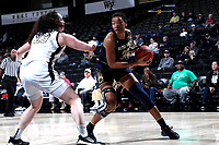 WINSTON-SALEM, NC - FEBRUARY 06: Mikayla Vaughn #30 of the University of Notre Dame is defended by Christina Morra #23 of Wake Forest University during a game between Notre Dame and Wake Forest at Lawrence Joel Veterans Memorial Coliseum on February 06, 2020 in Winston-Salem, North Carolina.