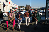 SOWETO, SOUTH AFRICA JULY 4: Sibu Sithole, Lethabo Tsatsinyane, Teekay Makwale and Floyd Avenue, young designers part of the group Smarteez at Jabulani shopping mall on July 4, 2014 in Jabulani section of Soweto, South Africa. Soweto today is a mix of old housing and newly constructed townhouses. A new hungry black middle-class is growing steadily. Many residents work in Johannesburg but the last years many shopping malls have been built, and people are starting to spend their money in Soweto. (Photo by: Per-Anders Pettersson)