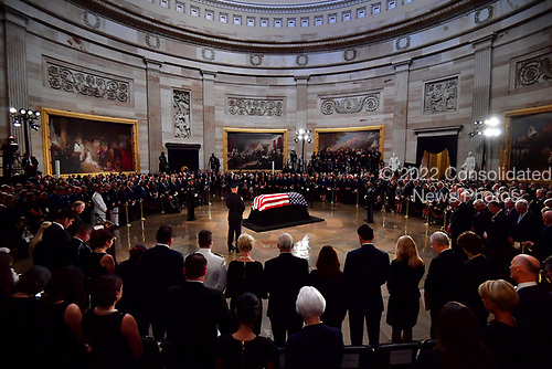 Mourners surround the casket of former Senator John McCain in the Capitol Rotunda where he will lie in state at the U.S. Capitol, in Washington, DC on Friday, August 31, 2018. McCain, an Arizona Republican, presidential candidate and war hero died August 25th at the age of 81. He is the 31st person to lie in state at the Capitol in 166 years.    Photo by Kevin Dietsch/UPI