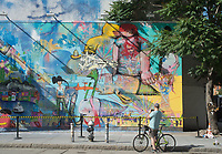 New York, NY 2 June 2016 - Man on a bicycle taking a picture of Korean artist David Choe's  at the Houston Bowery Mural. © Stacy Walsh Rosenstock