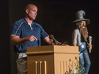 NWA Democrat-Gazette/ANTHONY REYES • @NWATONYR<br /> David Bevis gives a few remarks Friday, Sept. 11, 2015 at the Rogers Mountaineers Athletic Hall of Fame ceremony at the school in Rogers. Bevis was joined in this year's class by  Charlie Fredrick, Billy Joe Jones, Scott Pillstrom, Jim White and Kermit Womack. Each inductee was introduced and had a few moments to give thanks for the honor. The new inductees were given a reception after the ceremony and were introduced during halftime at that nights football game.