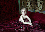 Iana, 3 years old in her home in Vyzovka, where many families were relocated after Chernobyl's disaster
