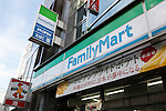 FamilyMart and Sunkus signboards on display at the entrance of their convenience stores on August 18, 2015, Tokyo, Japan. FamilyMart which is the nation's third-largest convenience store chain is expected to announce that it will acquire a smaller Nagoya-based operator ''Cocostore Corp.'' and its  657 stores. FamilyMart is also expected to integrate operations with UNY Group Holdings Co., which operates the country's fourth largest chain Circle K Sunkus Co., in September 2016. This would see the new group running about 18,400 stores in Japan, 500 more than the largest rival Seven-Eleven. (Photo by Rodrigo Reyes Marin/AFLO)