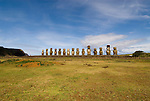 Chile, Easter Island: Array of statues or moai on a platform or ahu at Ahu Tongariki, near the quarry Rano Raruku.  This is the largest array of moia on Easter Island, consisting of 15 moai..Photo #: ch248-33842..Photo copyright Lee Foster www.fostertravel.com lee@fostertravel.com 510-549-2202